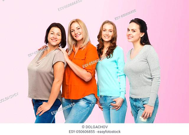 friendship, fashion, body positive, diverse and people concept - group of happy different size women in casual clothes over pink background