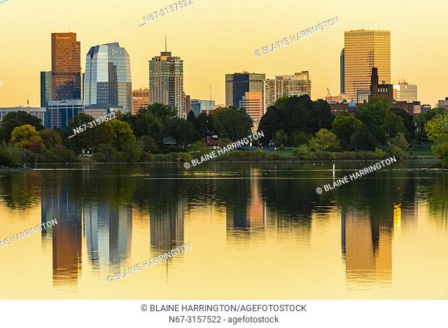 Sloans Lake at sunset with Downtown Denver in background, Colorado USA. Sloan's Lake is the biggest lake in Denver, and at 177 acres