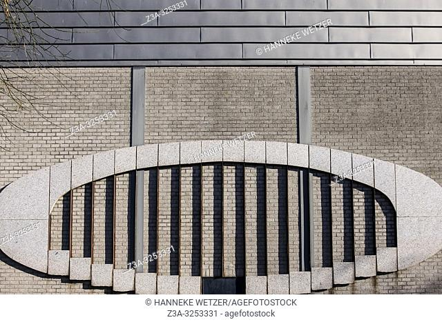Oval decoration on a wall in Amsterdam, the Netherlands, Europe