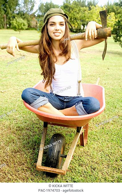 Hawaii, Kauai, Portrait Of Attractive Young Woman In A Crate