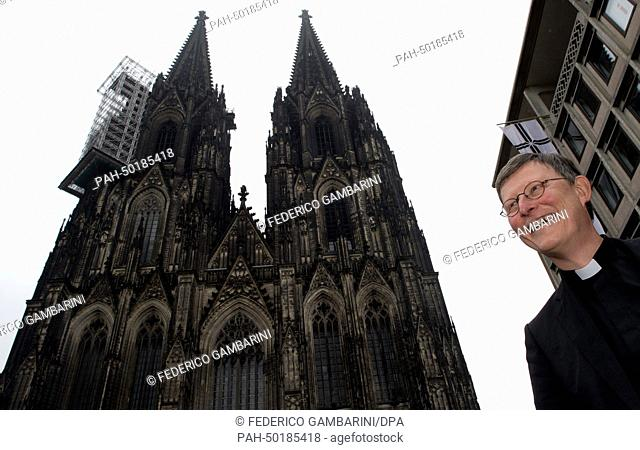 New archbishop of Cologne, Cardinal Rainer Maria Woelki, stands in front of the cathedral in Cologne, Germany, 12 July 2014