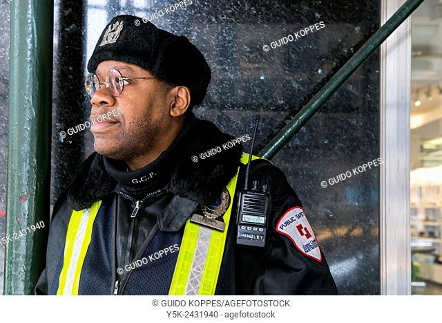 New York, USA. African American security guard on the lookout at Grand Central Station