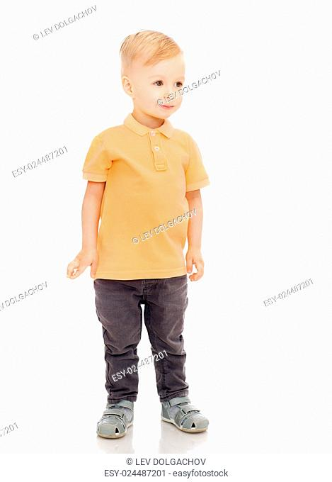 childhood, fashion and people concept - happy little boy in casual clothes