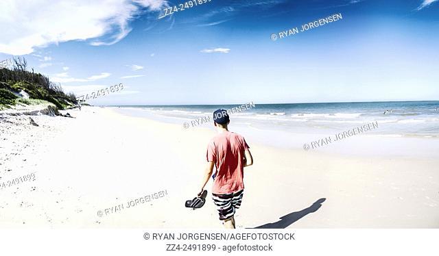 Panoramic view of an Australian traveller walking along a Queensland Beach. Taken Bribe Island, Australia
