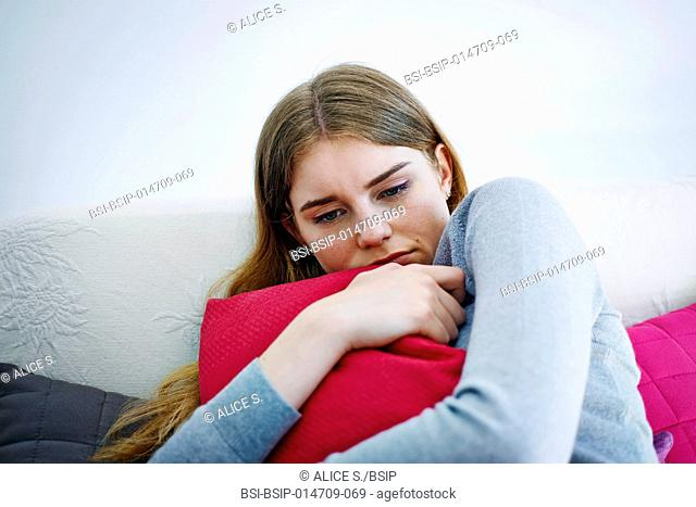 Woman hugging a cushion