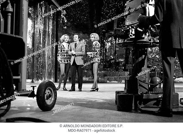 The twin sisters and well-known German variety showgirls Alice and Ellen Kessler shooting the TV show 'Canzonissima'. They became two Italian TV celebrities in...