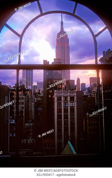 New York, NY - The Empire State Building, framed through a Manhattan office window