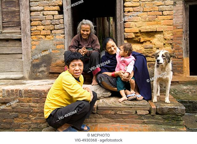 Family portrait of poor family outside their home in village of Bhaktapur a town near Kathmandu Nepal - 23/09/2020