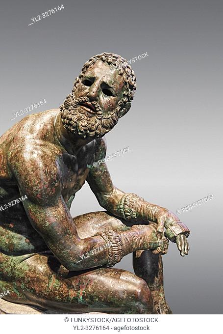 Rare original Greek bronze statue of an Athlete after a boxing match, a 1st cent BC. The athlete, seated on a boulder, is resting after a boxing match