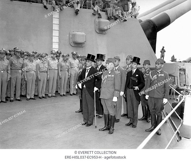 Japanese surrender signatories arrive aboard the USS MISSOURI in Tokyo Bay. Japanese Foreign Minister Mamoru Shigemitsu, in front with top hat