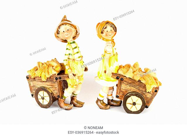 Boy and Girl Dolls with Corn Carts