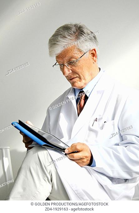Doctor with tablet in waiting room, Onkologikoa Hospital, Oncology Institute, Case Center for prevention, diagnosis and treatment of cancer, Donostia