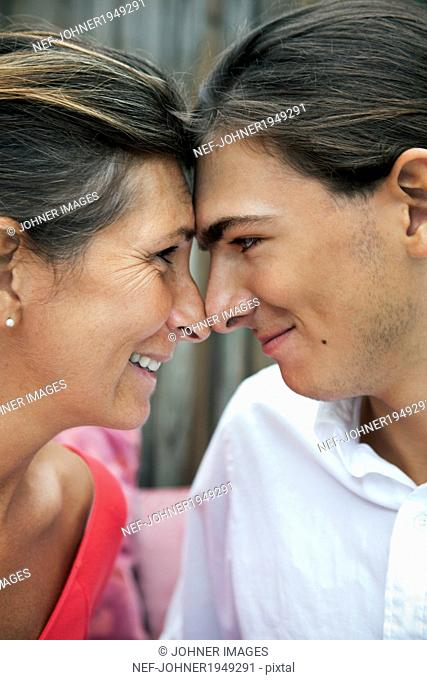Mature woman with teenage son, Sweden