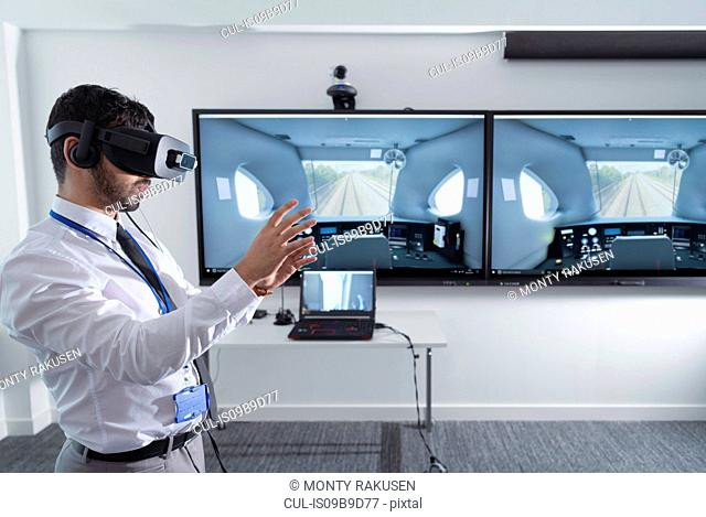 Engineering apprentice using Virtual Reality system in railway engineering facility