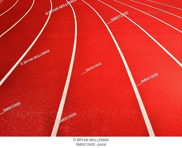 Lanes on running track recede into distance