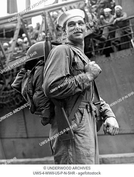 Davisville, Rhode Island: December 26, 1943.This Navy Seabee is heading off for duty in the South Pacific. The Seabees were founded here two years ago on...