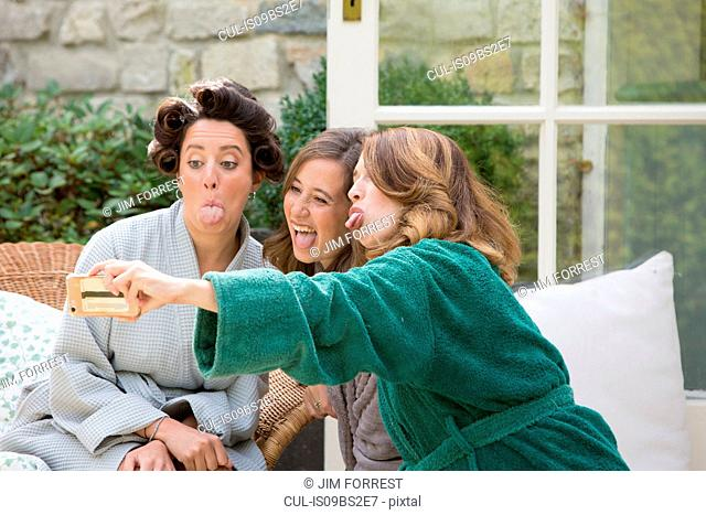 Bride and friends taking selfie on morning of wedding day