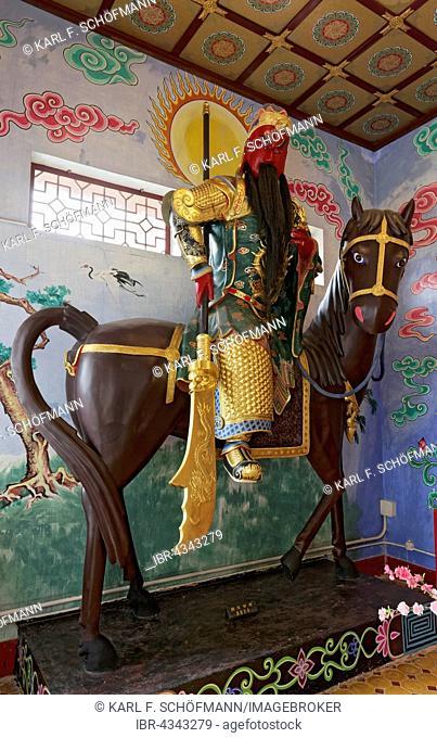 Figure of a Bodhisattva on horseback, Buddhist Avalokitesvara or Kwun Yam Temple, Ten Thousand Buddhas Monastery, Sha Tin, New Territories, Hong Kong, China