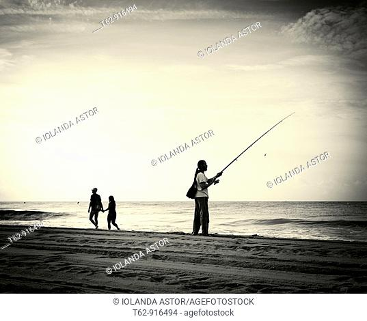 Angler on the beach  Mediterranean Sea