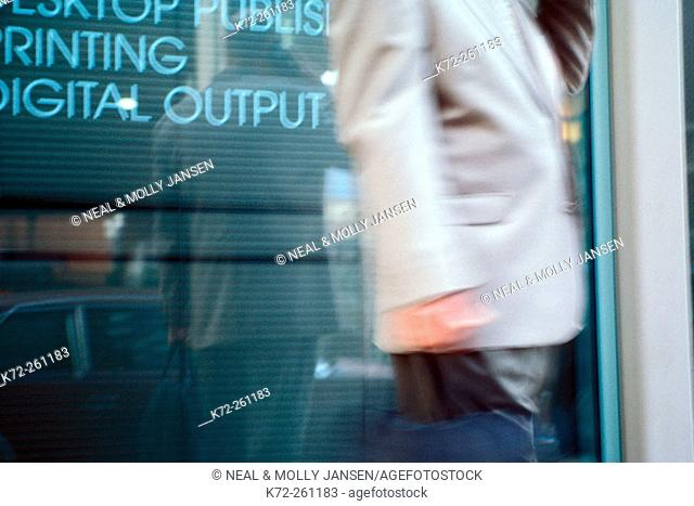man outside digital print shop