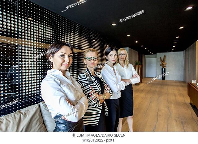 Group of businesswomen standing in lobby
