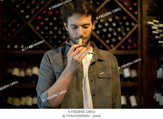 Sommelier smelling wine cork