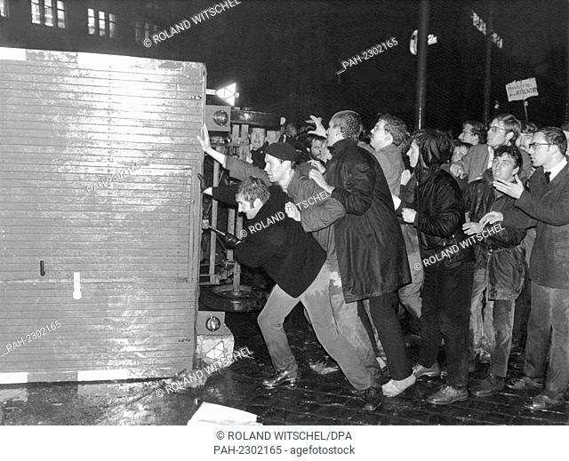 On the evening of 13 April 1968, young demonstrators try to barricade the exits in front of the Frankfurt Societäts-Druckerei