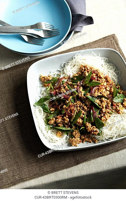 Plate of pork larb with noodles