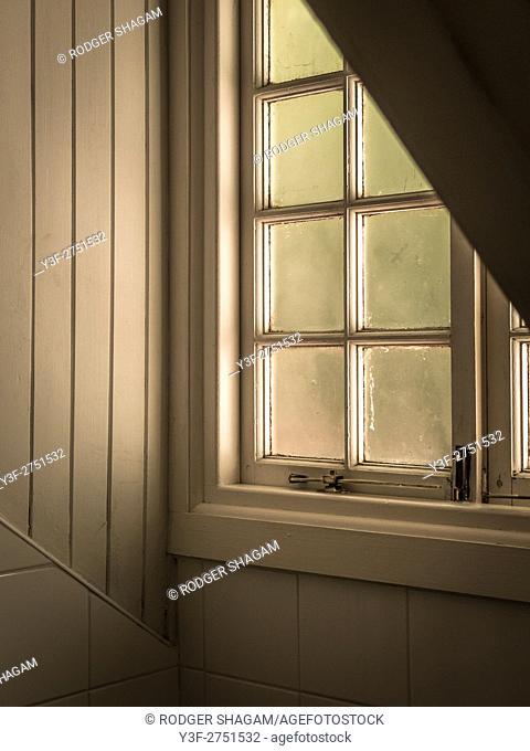 A loft window, frosted glass kjeeps out the glare