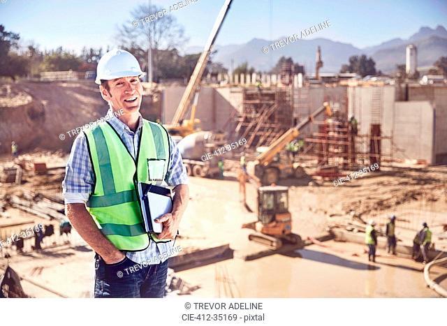 Portrait confident construction worker foreman at sunny construction site