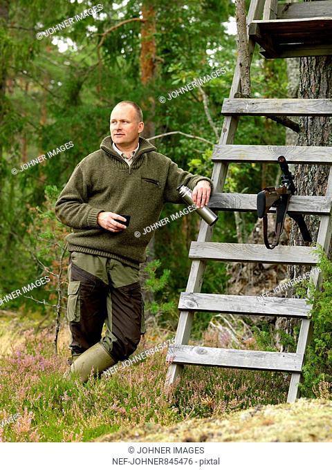 Sportsman waiting by a ladder, Sweden