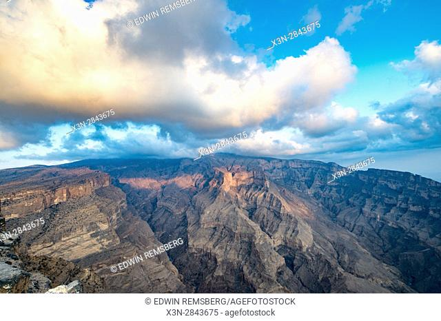 Oman; Sunlight pouring into mighty gorge at Oman's Grand Canyon; Jebel Shams