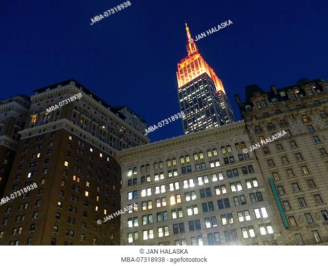 Illuminated red, Empire State Building photographer from Herald Square