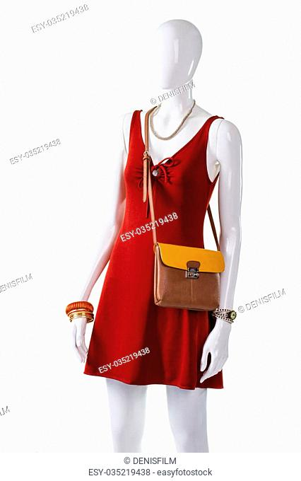 ba15cf51 Red keyhole dress with purse. Female mannequin wearing thin handbag. Casual  dress with handy