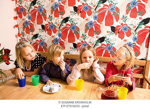 Children eating cookies, Sweden