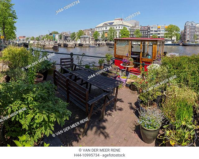 A mini-garden of a houseboat the river Amstel