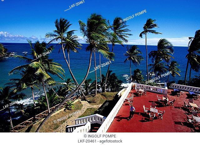 Terrace against ocean, Blue Haven Hotel Scarborough, Trinidad and Tobago, Caribbean