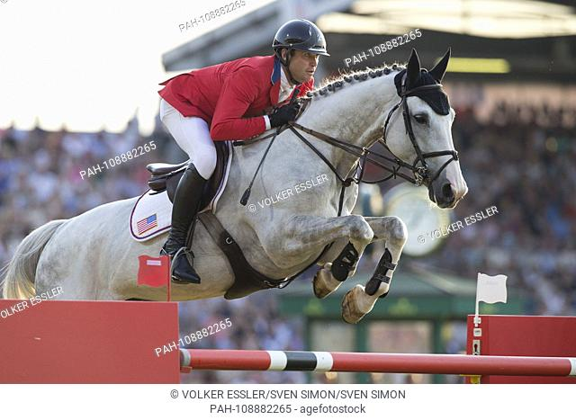 Devin RYAN (USA) on Eddie Blue in the jump over the obstacle, in the half profile. Action / single action. CHIO Aachen 2018, S8, Mercedes-Benz Nations Cup
