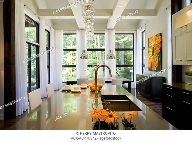 Kitchen and dining room inside an upscale residential home, Quebec, Canada. This image is property released. PR0187
