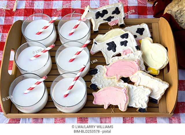 Milk and cookies on wooden tray