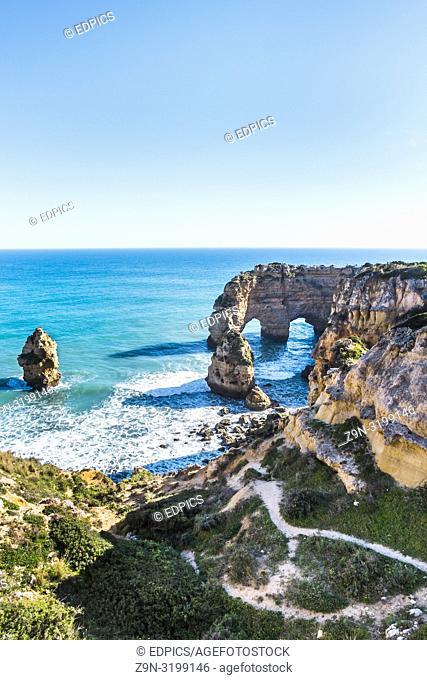 rock formation at praia da marinha, praia da marinha, caramujeira, algarve, portugal