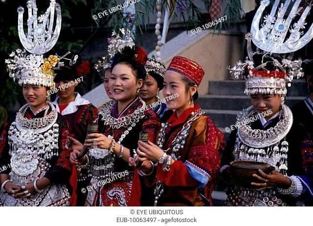 Miao girls in traditional festival costume with silver head-dresses