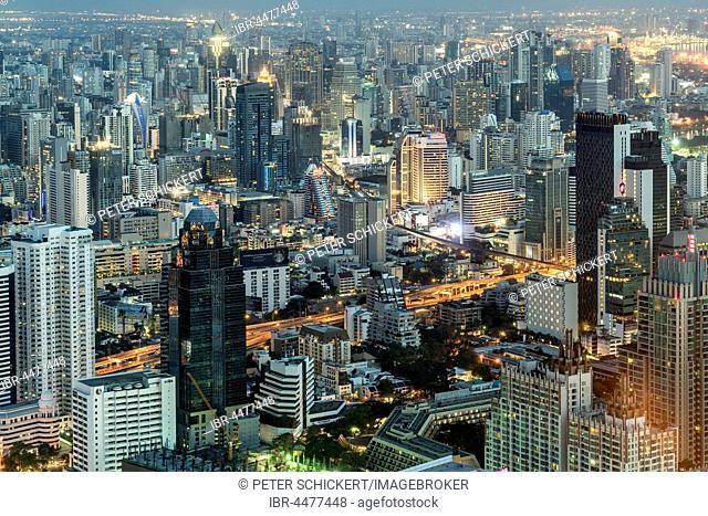 Skyline with skyscrapers, illuminated street, cityscape at dusk, Bangkok, Thailand