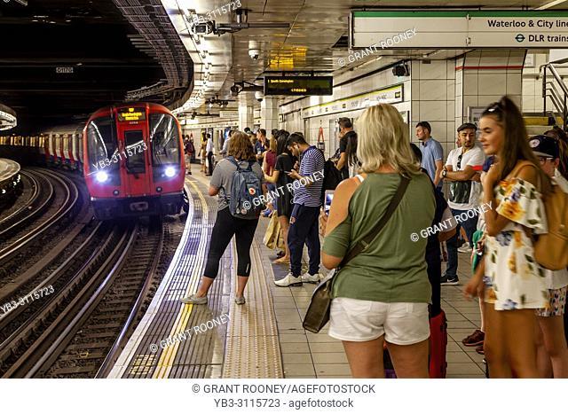 London Underground Passengers Waiting On The Platform, London, England