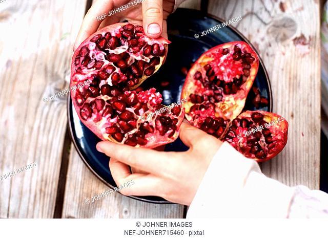 Pomegranate om a plate, Sweden