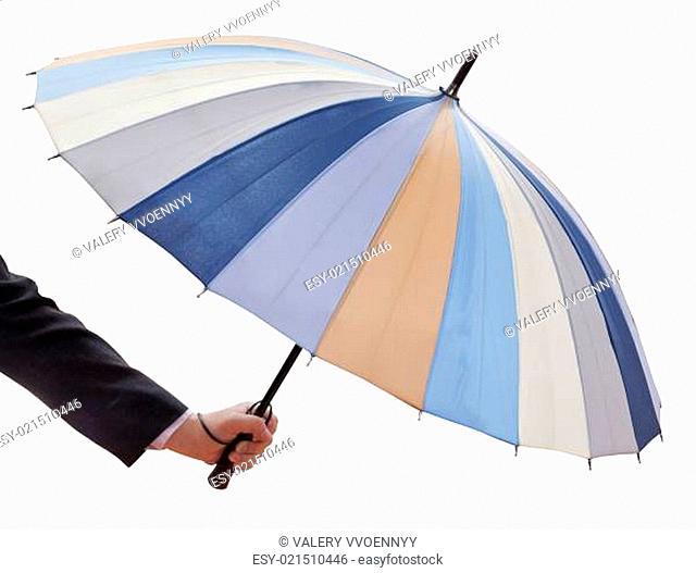 man's hand with open multicolored umbrella