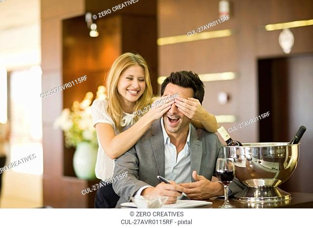 Couple having fun at bar