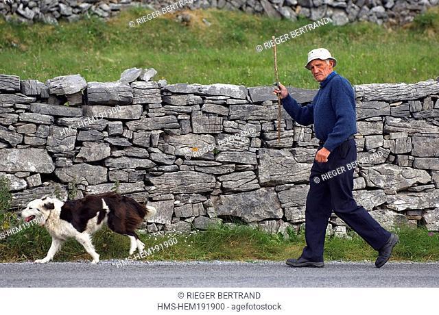 Ireland, County Galway, Aran Islands, Inishmore, man and his dog