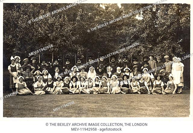 Pupils of Erith County School dressed for a performance of Gilbert and Sullivan. The pupils have individually signed the reverse of the postcard