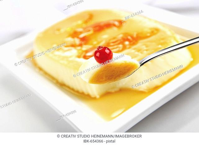 Crème caramel garnished with a redcurrant